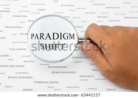 The word PARADIGM SHIFT is magnified.