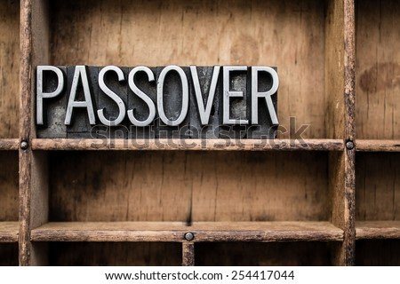 "The word ""PASSOVER"" written in vintage metal letterpress type in a wooden drawer with dividers. - stock photo"