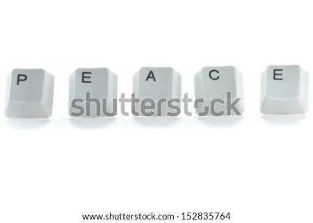 the word peace spelled using key board keys on a white background - stock photo