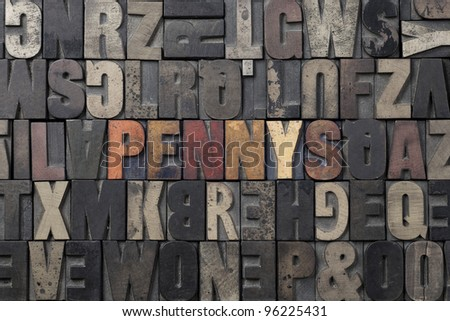 The word Pennys written in antique letterpress printing blocks. - stock photo
