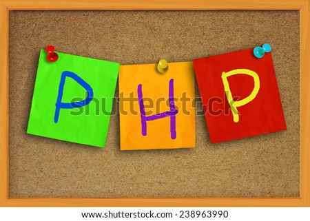 The word PHP written on sticky colored paper over cork board - stock photo