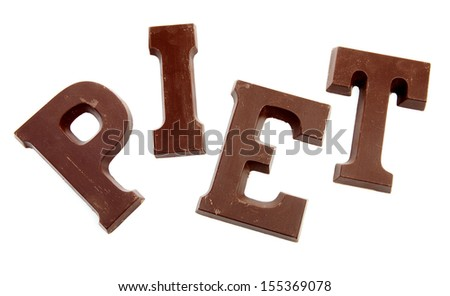 "The word ""PIET"" in chocolate letters isolated on white background, typical Dutch candy for a event in december - stock photo"