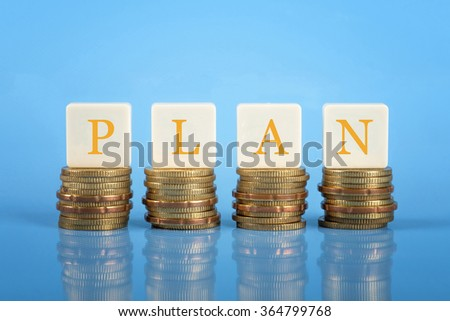 The word Plan on stacked coins, financial planning conceptual