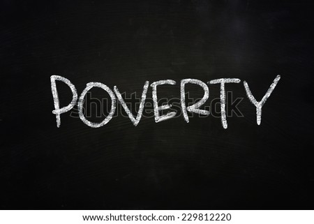 The word Poverty written with chalk on blackboard