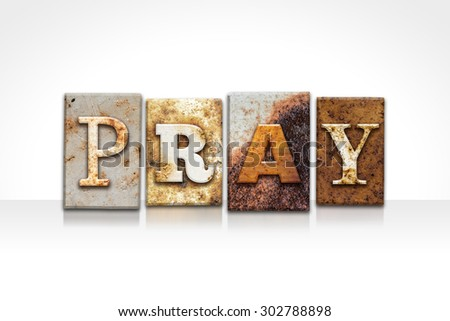 """The word """"PRAY"""" written in rusty metal letterpress type isolated on a white background. - stock photo"""