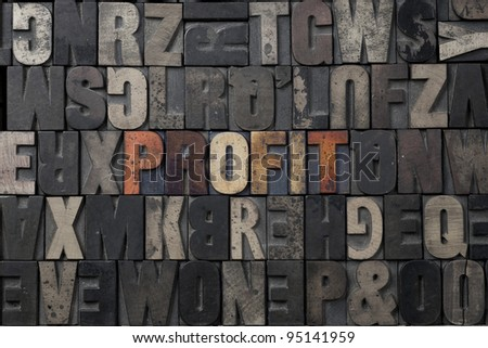 The word Profit written in antique letterpress printing blocks. - stock photo