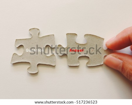 "The word ""question"" and ""answer"" on the puzzle pieces."