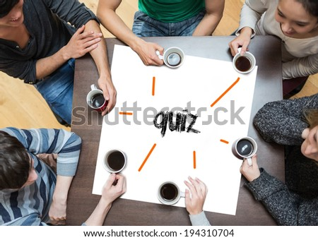 The word quiz on page with people sitting around table drinking coffee - stock photo