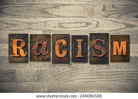 "The word ""RACISM"" written in wooden letterpress type. - stock photo"
