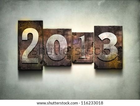 "The word ""2013"". Random letterpress type on grunge background. - stock photo"