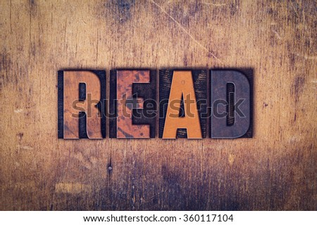"The word ""Read"" written in dirty vintage letterpress type on a aged wooden background. - stock photo"