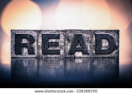 "The word ""READ"" written in vintage ink stained letterpress type. - stock photo"