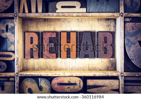"The word ""Rehab"" written in vintage wooden letterpress type."