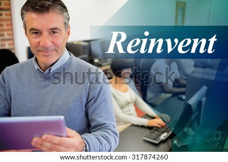 The word reinvent against teacher holding a tablet pc - stock photo