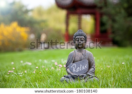 The word Relax with Buddha Statue - stock photo