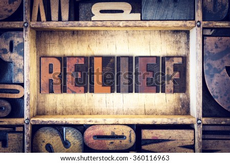 "The word ""Relief"" written in vintage wooden letterpress type."