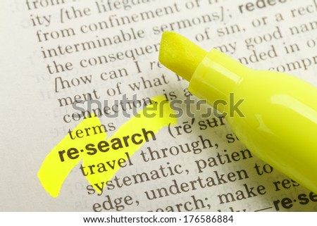 The Word Research Highlighted in Dictionary with Yellow Marker Highlighter Pen. - stock photo