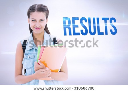 The word results and student holding notebooks against grey background - stock photo