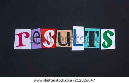 The word results in cut out magazine letters on blackboard