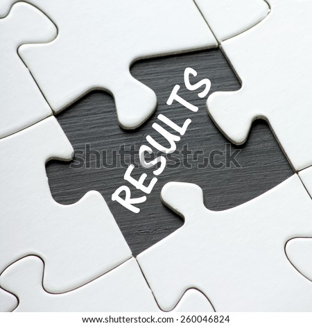 The word Results on a blackboard revealed by a missing jigsaw puzzle piece - stock photo
