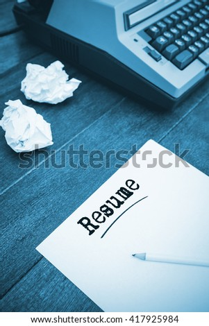 The word resume against view of an old typewriter and paper
