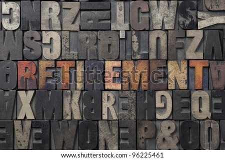 The word Retirement written in antique letterpress printing blocks. - stock photo