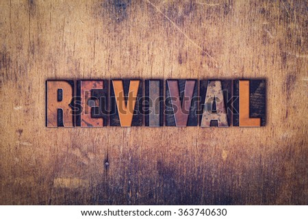 "The word ""Revival"" written in dirty vintage letterpress type on a aged wooden background. - stock photo"
