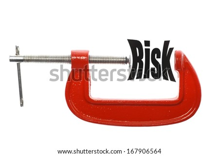 """The word """"Risk"""" is compressed with a vice. Business metaphor. - stock photo"""