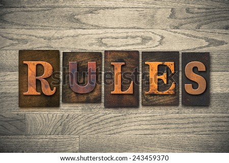 "The word ""RULES"" written in wooden letterpress type. - stock photo"