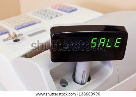 The word SALE on the display of a cash register - stock photo