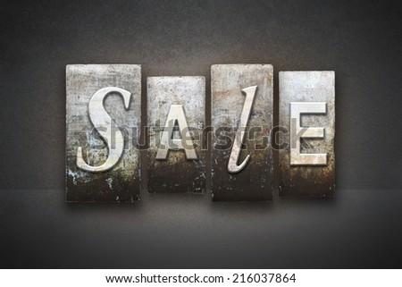 The word SALE written in vintage letterpress type - stock photo