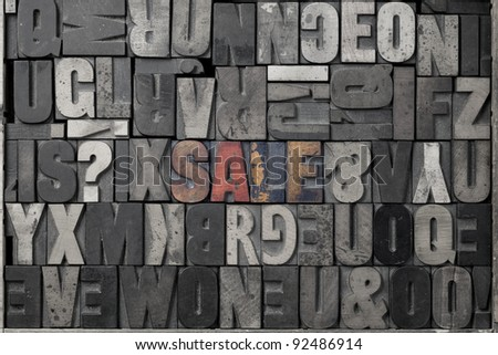 The word sale written out in old letterpress blocks. - stock photo