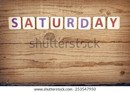 The word SATURDAY written in wooden letterpress type. - stock photo