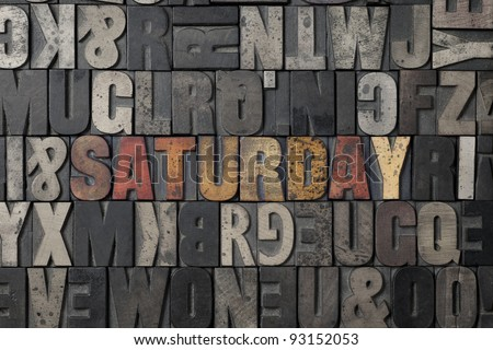 The word Saturday written out in old letterpress blocks. - stock photo