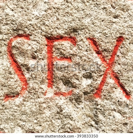 The word SEX set in stone as part of an old Roman inscription.