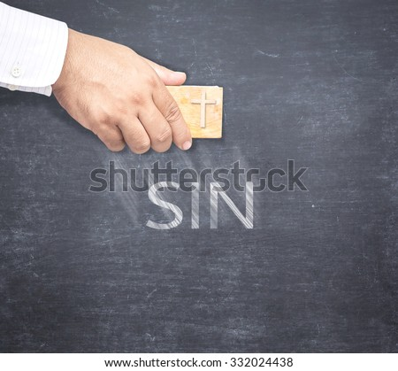 The word SIN being erased from a chalkboard. Concept of Jesus erasing sin.  - stock photo