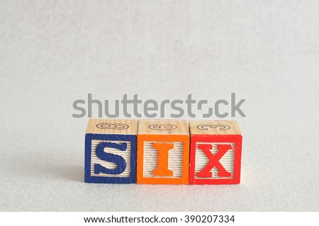 The word six (6) spelled with colorful alphabet blocks isolated against a white background - stock photo