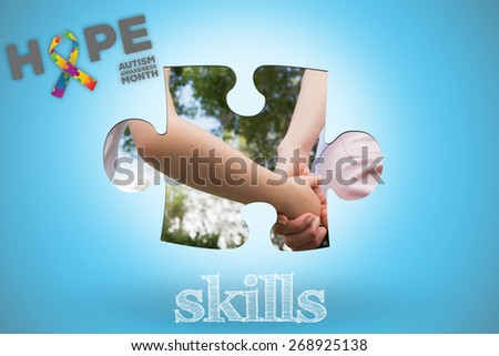The word skills and autism awareness month against blue background with vignette - stock photo