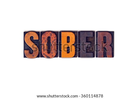 "The word ""Sober"" written in isolated vintage wooden letterpress type on a white background."