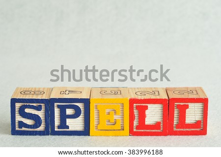 The word spell spelled with colorful alphabet blocks isolated against a white background - stock photo