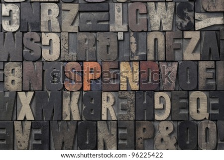 The word Spend written in antique letterpress printing blocks. - stock photo