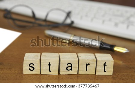The word start on wood stamp