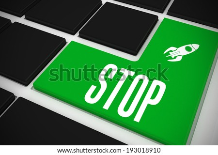 The word stop and rocket ship on black keyboard with green key