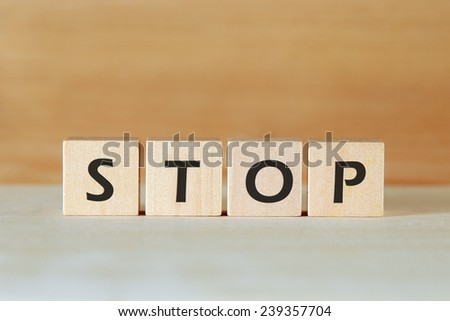 the word STOP on wood blocks