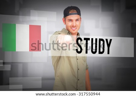 The word study and man smiling and wearing baseball hat backwards and pointing against abstract white room - stock photo