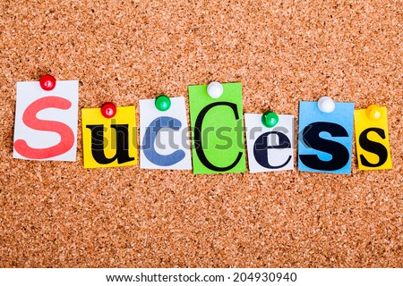 The word Success in cut out magazine letters pinned to a cork notice board - stock photo