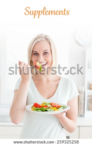 The word supplements against portrait of a charming woman enjoying mixed salad - stock photo