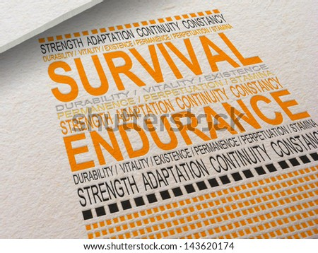 The word Survival letter pressed into paper with associated words around it. - stock photo
