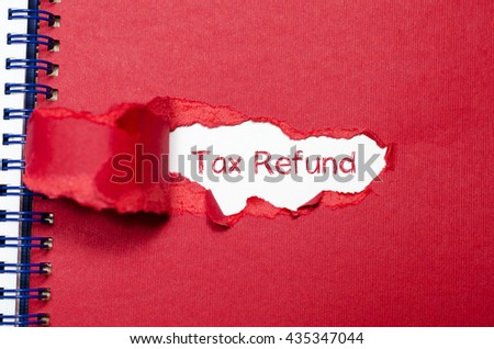The word tax refund appearing behind torn paper. - stock photo