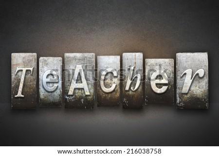 The word TEACHER written in vintage letterpress type - stock photo